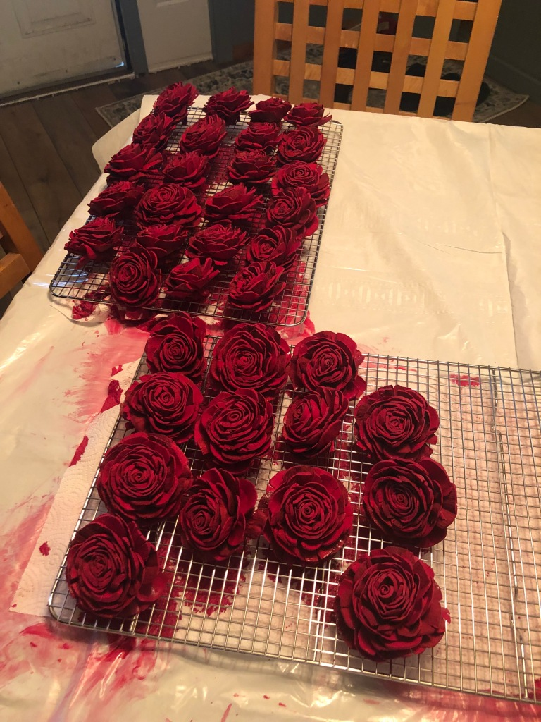red dyed sola flowers